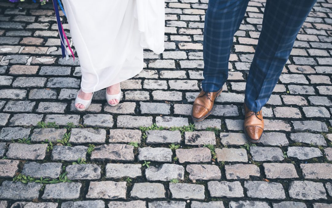 Bride & Groom feet as they walk down Liverpool cobbled street