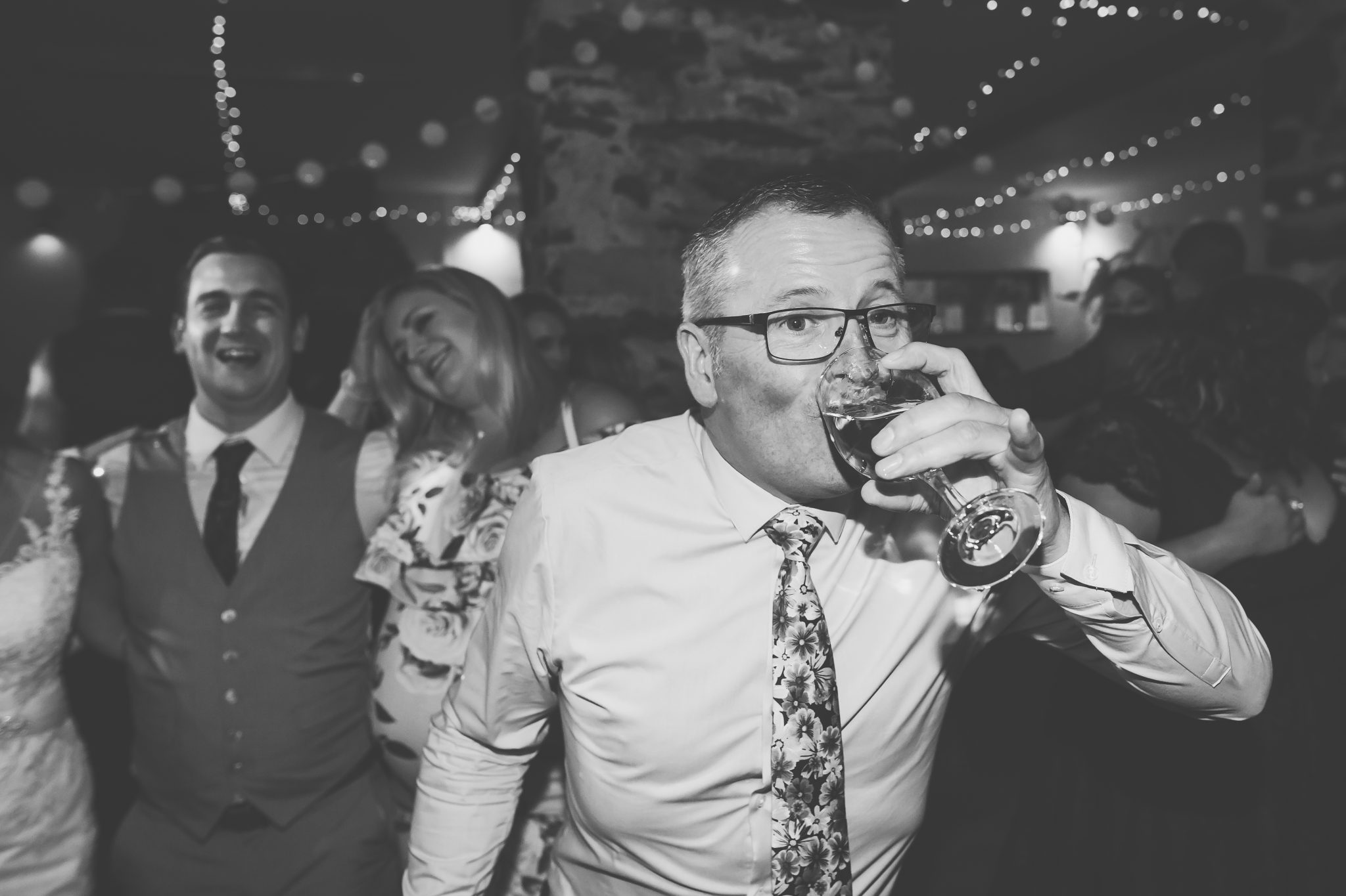 Wedding guest nearly falling with his drink