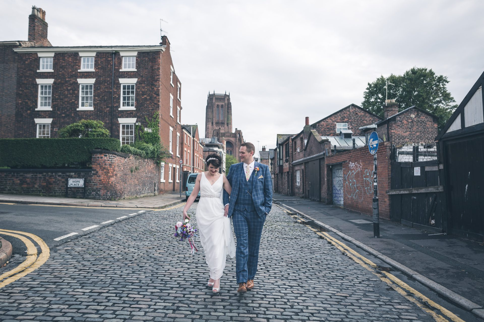 Bride and Groom stroll down Pilgrim Street In Liverpool