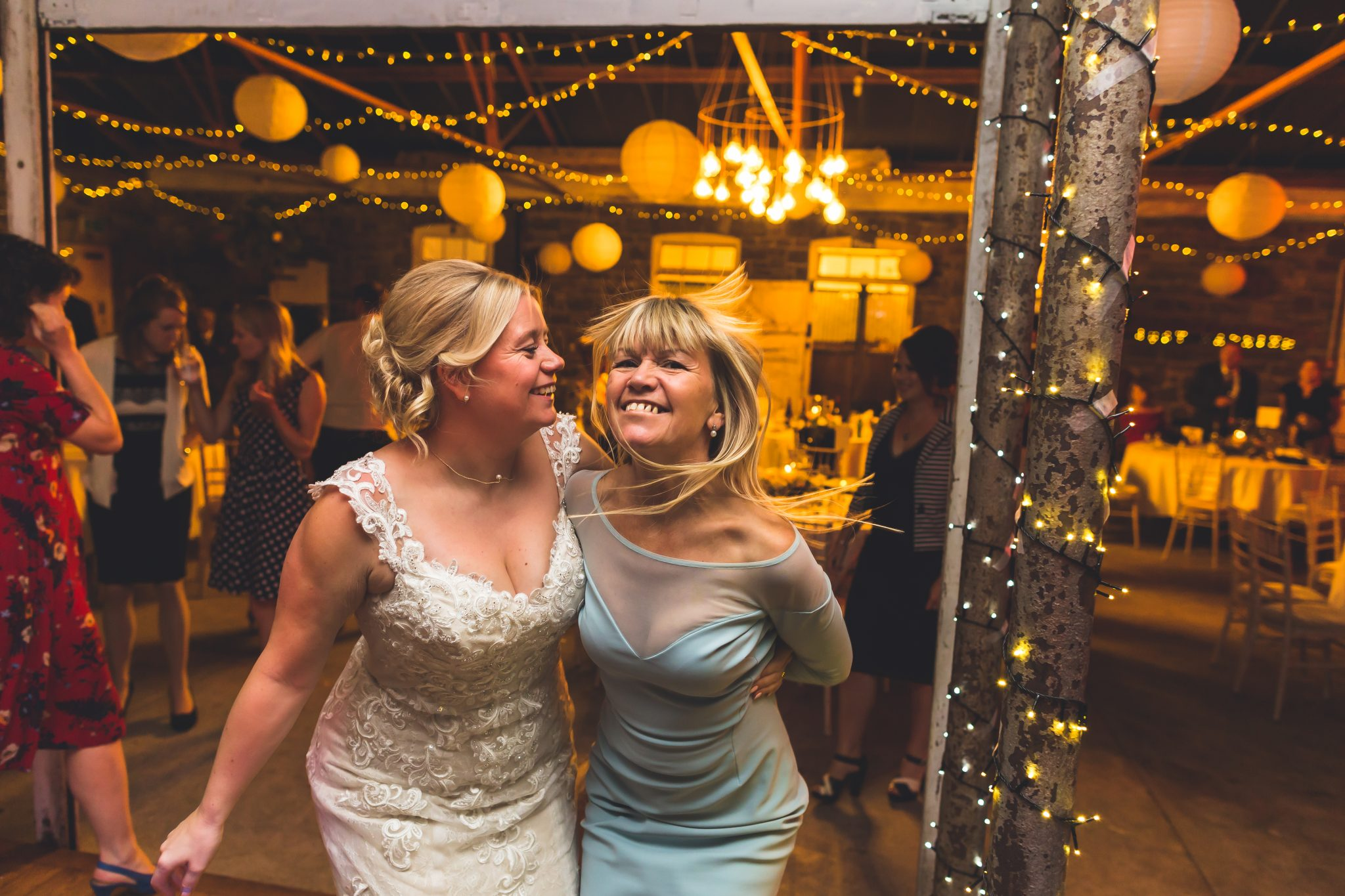 Mother and Bride dancing at the wedding at Plas Dinam House