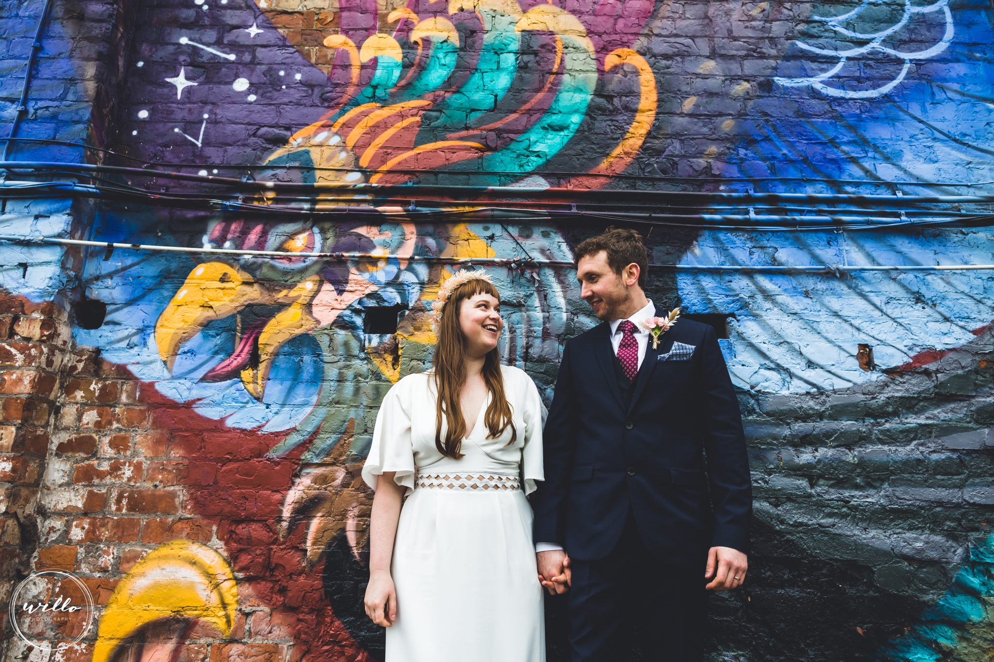 Bride and Groom wedding portrait with street art at their Constellations Liverpool wedding