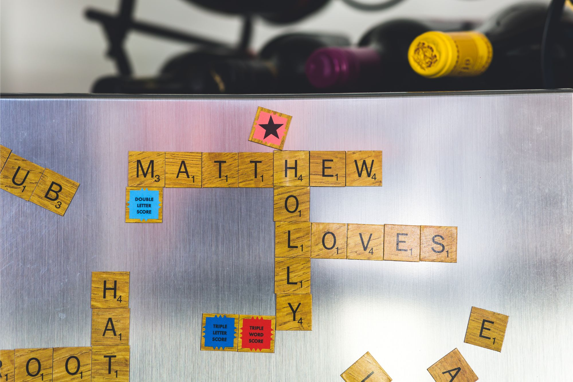 Bride & Groom names made out of Scrabble pieces on wedding day