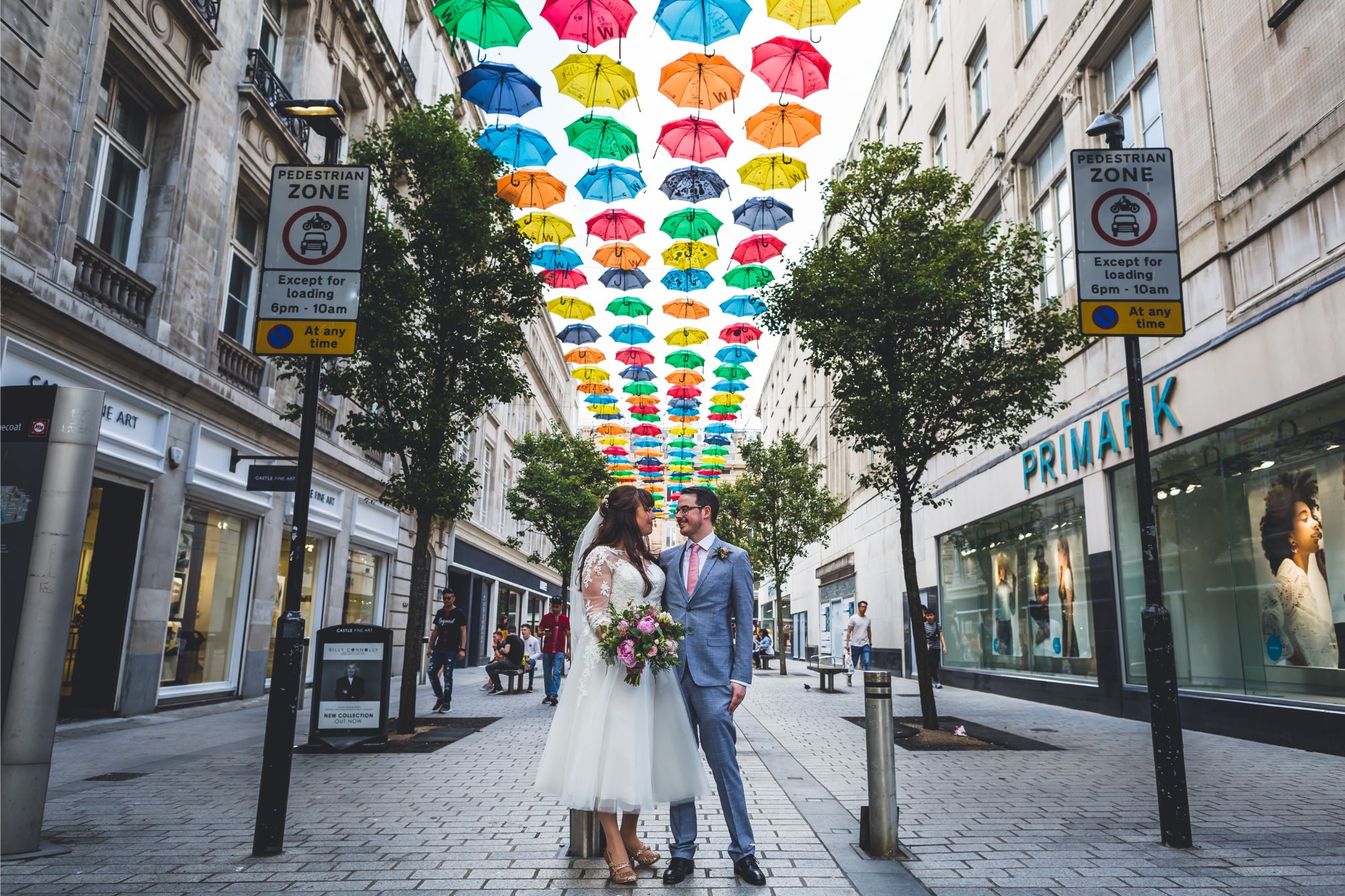 Bride and Groom wedding portrait at Bluecoat Liverpool under colourful umbrellas