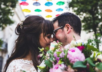 Bride & Groom share a moment under coloured umbrellas at Bluecoat Liverpool