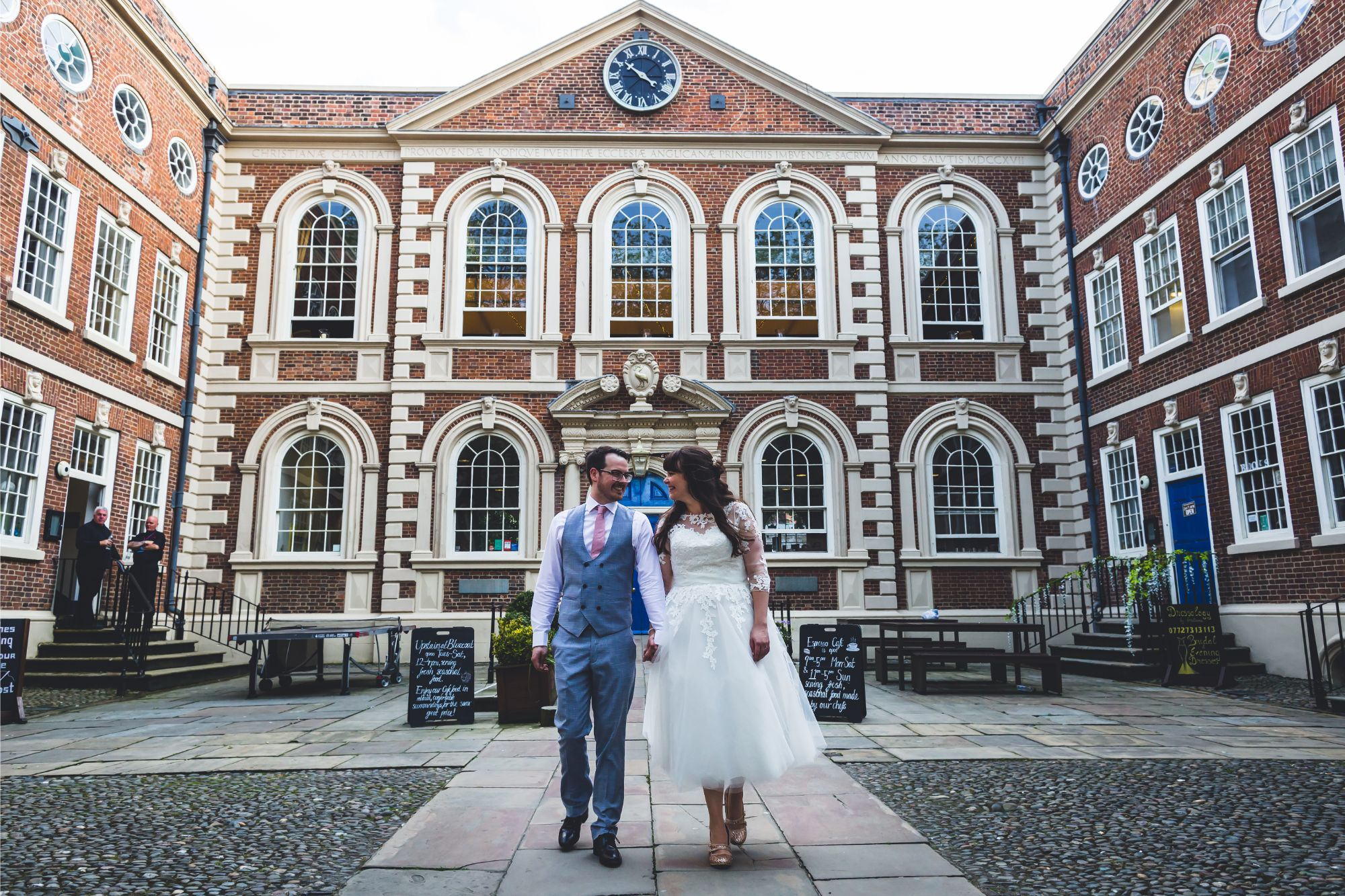 Bride & Groom walk through the courtyard of The Bluecoat Liverpool