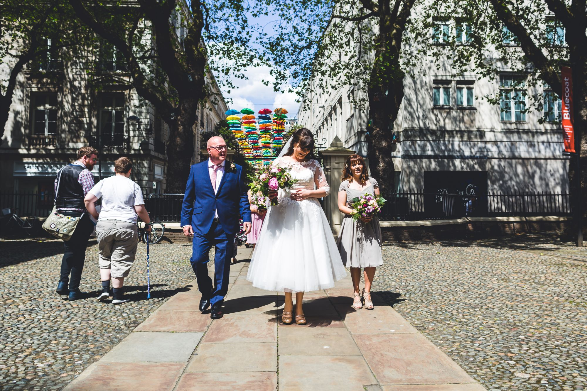 Bride walks into Bluecoat Liverpool with Father and Bridesmaids
