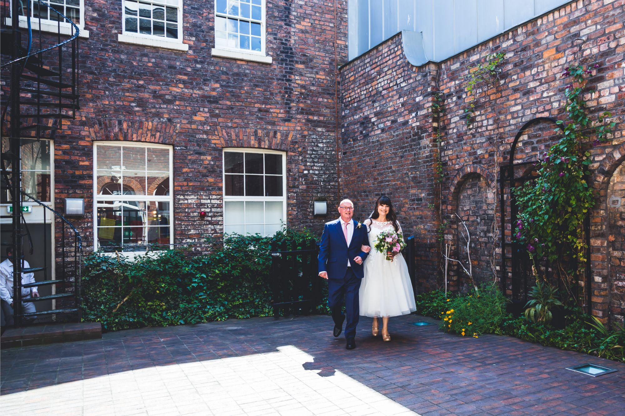 Bride & Father walk through Bluecoat Liverpool