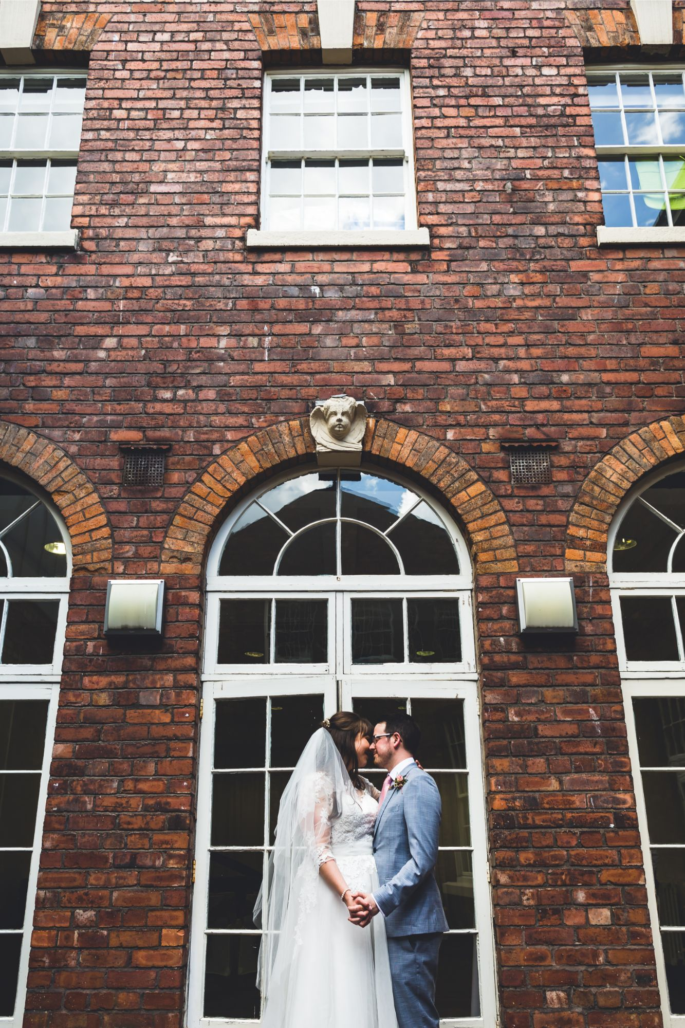 Bride and Groom wedding portrait in courtyard of Bluecoat Liverpool